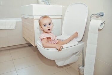 Baby sitting on the toilet