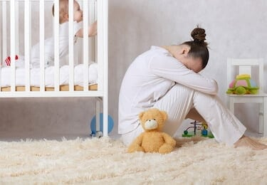 Young mother between 30 and 40 years old is experiencing postnatal depression