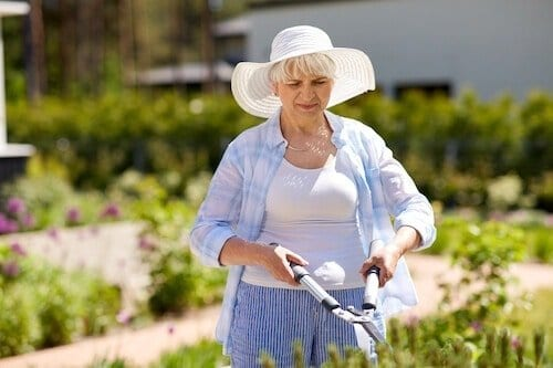 Happy senior woman gardening