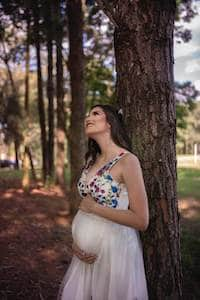 young woman baby bump started showing