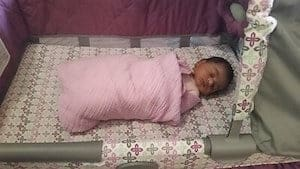safe swaddle in a crib