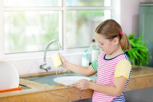 child helping mom on household chores