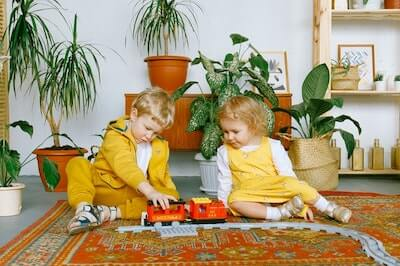 brother and sister playing with toy train