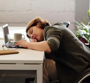 tired woman on table taking nap